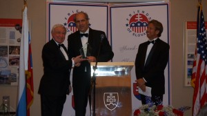 Joe Senko presents Amb. Burian with an award for diplomacy as Ed Zelenak looks on