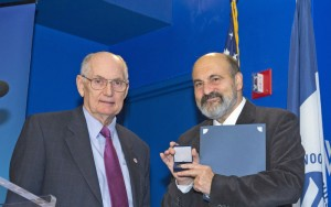 Amb. Ted Russell presents medal to Msgr. Tomas Halik
