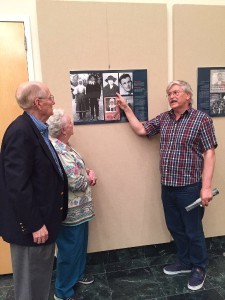 Slovak Film Director Dusan Hudec points out photos of the Praskac and Rehus families who sheltered downed U.S. pilot Owen Sullivan in WWII to FOS members Julie Slavik and Amb. Ted Russell