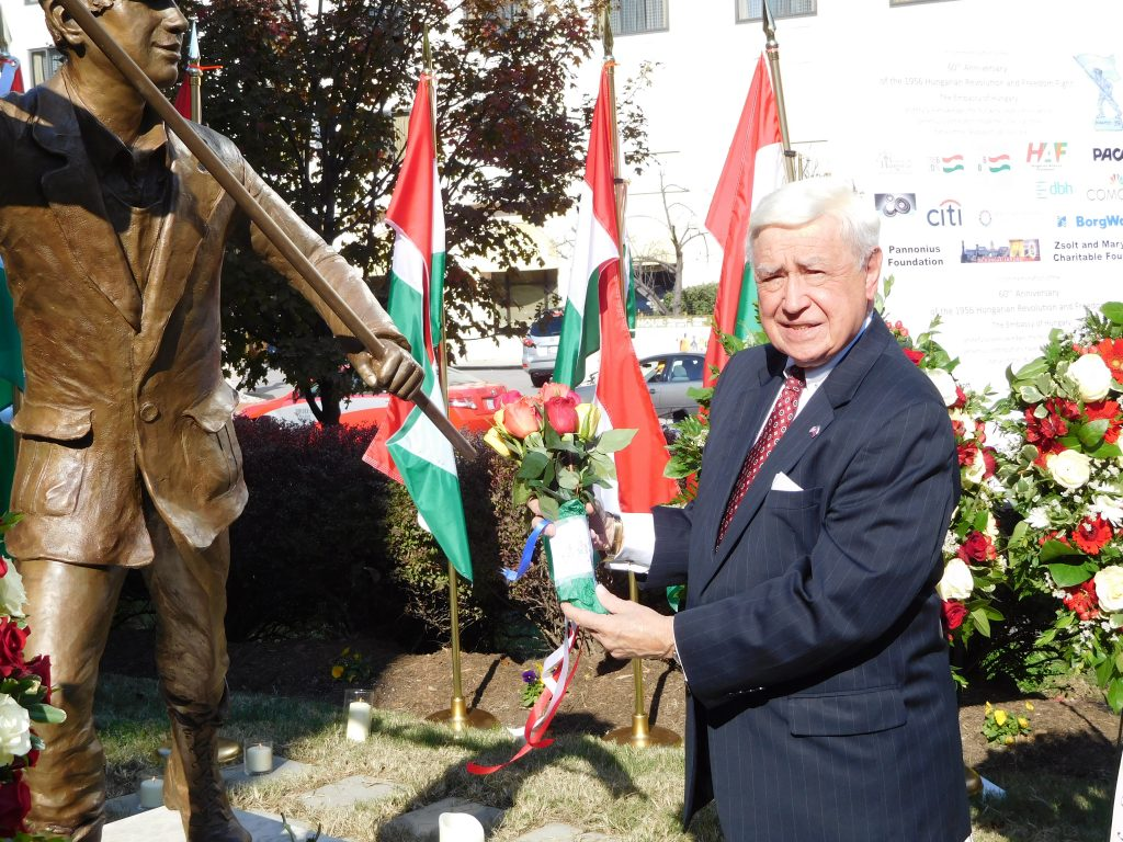 FOS Chairman Joe Senko lays flowers at the 'Budapest Lad' statue