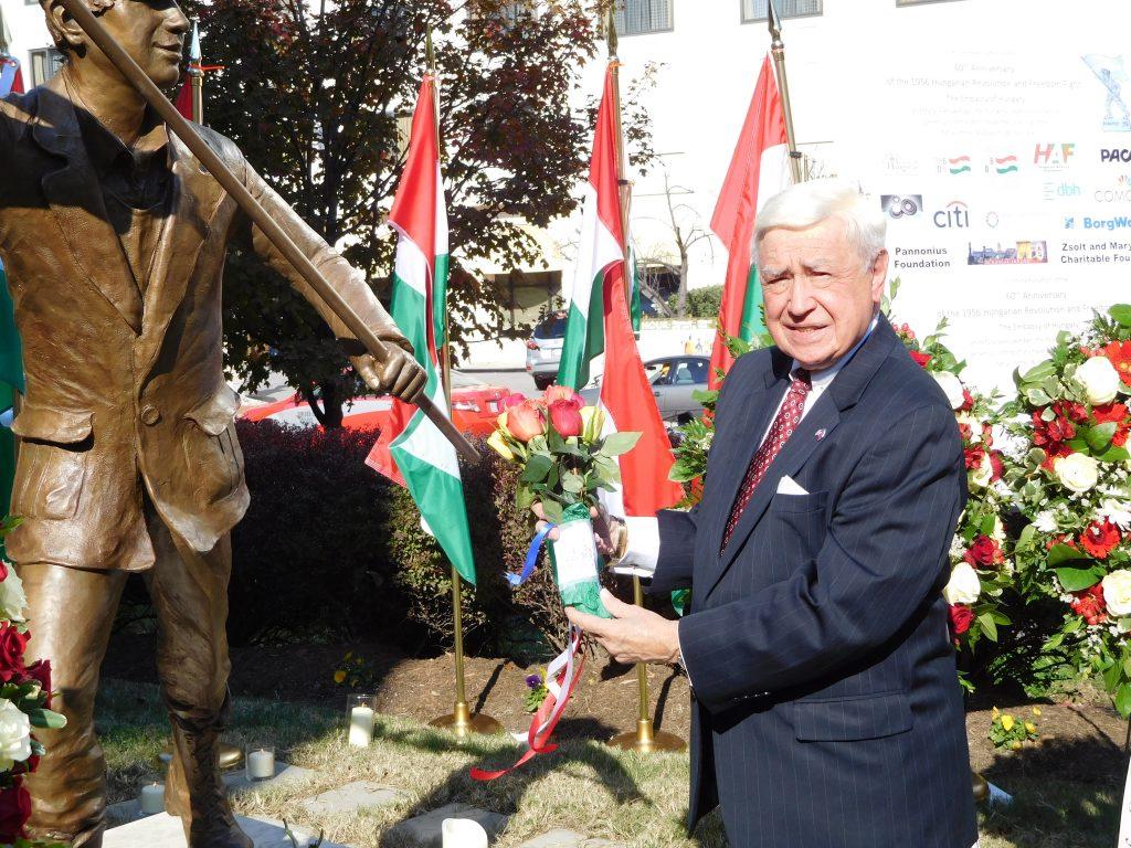 FOS Chairman Joe Senko lays flowers at the 'Budapest Lad' statue
