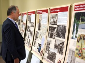 Pavol Demes, Transatlantic Fellow, the German Marshall Fund--Bratislava, views panel exhibit.
